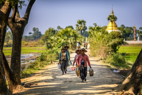 Farm workers walking in Mandalay, Myanmar